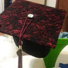 Grad cap, burgundy lace under black lace for classy and understated but unique grad cap decor. Finished off with a big shiny rhinestone on the brad for a pop!