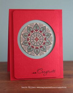 handmade card ... beautiful red ... the card and the main layer being the same color but popped up and obviously smaller than the base ... window has a Mehndi style mandala ... colored with Copics and high lighted with white gel pen ,.. gorgeous !!