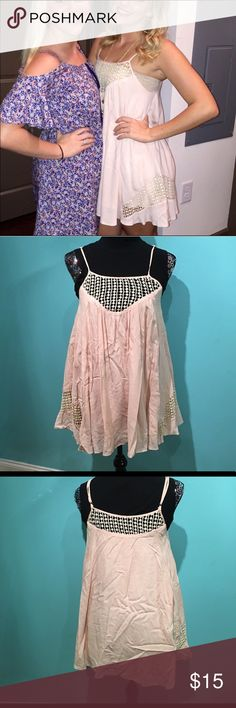 Blush sundress This blush/light pink dress is lightweight and flowy, making it perfect for layering! It has adjustable spaghetti straps. Wrinkled from being in storage but in excellent condition!  🖤All items are in great condition and come from a smoke-free home 🖤I consider reasonable offers but NO TRADES!! 🖤Bundle 3+ items for 15% off 🖤I do not model, but feel free to ask for more pics 🖤Comment if you have any questions Solemio Dresses Mini