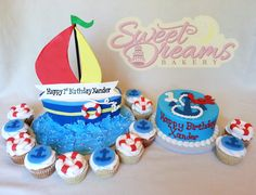 Sail boat party cake, smash cake and cupcakes. All of the decorations are marshmallow fondant.