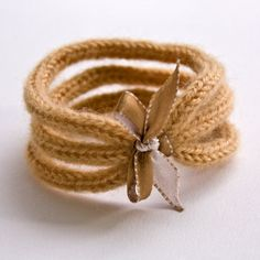 French Knitted Wool Bracelet with Ribbon - Inspiration only.  No pattern.  Yes, it's knitted--not crocheted-but I must try to duplicate in crochet!  Finished product for sale on Etsy.