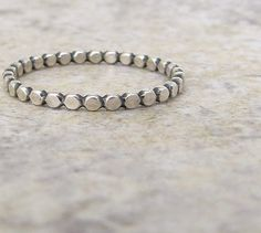 Stacking Ring Silver Dot Ring Hammered Silver Stacking Beaded Ring Silver. $15.00, via Etsy.