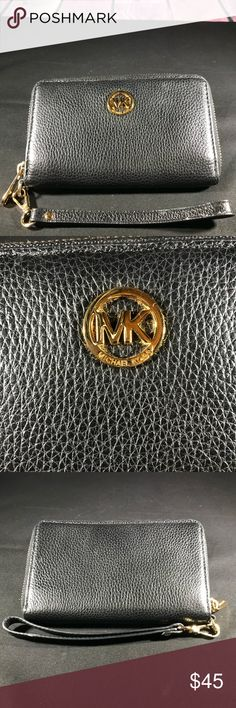 Michael Kors Black Leather Wristlet Wallet Purchased on Posh as NWOT but it was too small for my phone. This wallet phone wristlet is in excellent condition. Fits an iPhone 6. Measures 6.5 x 3.5 tall.   Use as wallet or wristlet. Never used it because of size. Michael Kors Bags Clutches & Wristlets