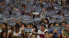 """#jesuischarlie #jesuisahmed Members of Sydney's French community gather in the heart of the city to hold aloft banners reading """"Je Suis Charlie"""" (I am Charlie) on January 8, 2015, in tribute to the victims killed after gunmen opened fire in the offices of French satirical weekly Charlie Hebdo  in Paris the day before. (AFP Photo/Peter Parks)"""