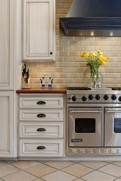 I am all about interior brick walls in kitchens.