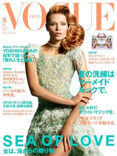 Sea Siren – Natasha Poly looks as glam as ever in a sea foam green Chanel dress and pearl necklace for the May cover of Vogue Japan. The Russian beauty poses for Daniele & Iango with wavy locks on display.