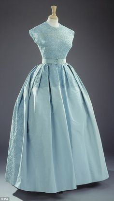 British couturier Norman Hartnell, who first worked for the then Princess Elizabeth in the 1940s, created this elegant gown for her sister's nuptials, pictured without the matching bolero