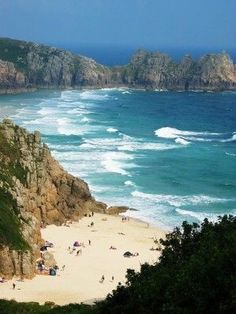 Porthcurno Beach in Cornwall, England - This is a wonderful beach that not many people would think is in the UK. It is beautiful on a hot day. This is an example of a natural attraction. Devon And Cornwall, Cornwall Coast, Cornwall Beaches, West Cornwall, Holidays In England, Walking Holiday, England And Scotland, English Countryside, Beautiful Beaches