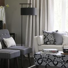 Clarke and Clarke - Sonoma Fabric Collection - Two monochrome zigzag chairs, a white sofa, a black and white patterned footstool, matching cushions, plain curtains and a black floor lamp Plain Curtains, Clarke And Clarke Fabric, Made To Measure Blinds, Black Floor Lamp, White Sofas, Fabric Houses, Curtain Fabric, Innovation Design, Decor Interior Design