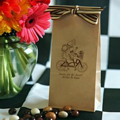 On the road for their journey of a lifetime! Riding a bicycle built for 2 requires cooperation, balance and endurance; essential qualities for any lasting marriage. This kraft #weddingfavorbag will delight your wedding guests.  It is lined  and FDA approved for direct food contact. It self-seals to keep your goodies fresh. Exclusively from www.FavorsYouKeep.com/favorCaitlin.html. Call us if you have any questions at 512.323.0600  #weddingfavorsbicycle #bagsforcandybuffet #bagsforcookiebuffet