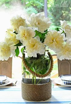 Sometimes it's fun to mix things up a little. This nautical feeling glass lantern from @homegoods also works well as a vase loaded full of creamy white peonies. (sponsored pin)