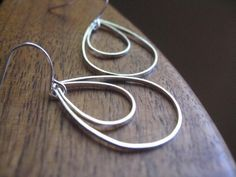 modern silver earrings. geometric earrings. rain drop earrings. peacock earrings. splurge. by splurge, $24.00 USD