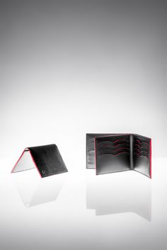 """""""Bristol"""" vertical compact card-holder Size: 8x10.5 cm Model shown in black caviar full-grain goatskin Black leather inner lining in smooth calfskin and red hand-boarded goatskin PM15C0012-CACN  """"Gambetta"""" wallet Size: 11x9cm Model shown in black caviar full-grain goatskin Black leather inner lining in smooth calfskin and red hand-boarded goatskin PM15C0010-CACN  www.anonyme-paris.fr"""