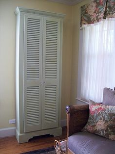 magazine cabinet made from old shutter doors and repurposed Small Handmade Home, Louvered Bifold Doors, Furniture Makeover, Diy Furniture, Cabinet Furniture, Louvre Doors, Old Shutters, Bedroom Shutters, Window Shutters