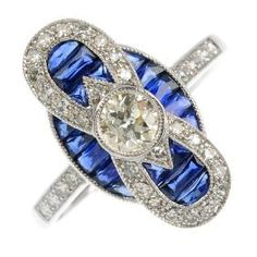 Lot: A sapphire and diamond dress ring. Of geometric design,, Lot Number: 0400, Starting Bid: £1,000, Auctioneer: Fellows, Auction: Jewellery, Date: July 6th, 2017 CDT