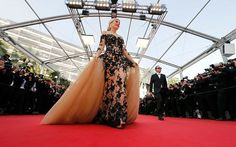 Actress and model Hofit Golan poses on the red carpet as she arrives for the opening ceremony and the screening of the film 'La tete haute' out of competition during the 68th Cannes Film Festival in Cannes, southern France, May 13, 2015.