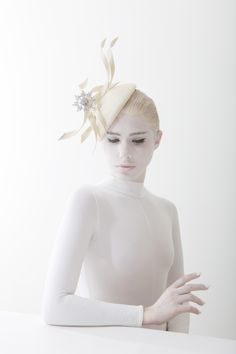 Parasisal beret with multi buntal ribbons with Swarovski crystals and crystal brooch | Philip Treacy | Spring/Summer 2014