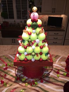 Awesome Christmas tree centerpiece made with tennis balls my friend made for our tennis party!