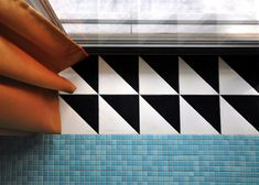 http://www.dezeen.com/2015/07/24/point-supreme-postmodern-touches-nadja-apartment-athens-patterned-tiles-geometric-screens-yellow-staircase/