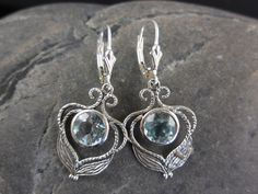 Made with 8mm round faceted blue topaz gemstones and sterling silver with leverback earring wires.