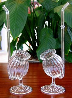 The previous pinner called this a Glass Absinthe Sipping Pipe, but I think it was designed for a different vice.