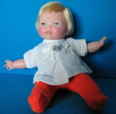 Thumbelina doll from 60's-- Loved this little doll. You pulled the string and she wiggled around! Probably my first baby doll.