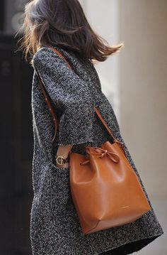 Adriana Gastélum is wearing a brown bucket bag from Mansur Gavriel