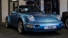 1993 reg, 74827 miles, Auto 3596cc Petrol, 2 door Convertible, Horizon Blue Metallic. FACTORY OPTIONS: 3 Spoke Porsche Crested Steering Wheel, 383 - Sports Seat Left with Electric Height Adjustment, 387 - Sports Seat Right with Electric Height Adjustment, 567 Tinted Top Windscreen, 690 CD Radio Porsche / Alpine CD10, Exceptionally Rare & Collectable Vehicle, Headlamp Washer System, RS Style Brake Ducts, Tiptronic S, Turbo Style Alloy Wheels, Very Rare Factory 964 Turbo Wide Bodied