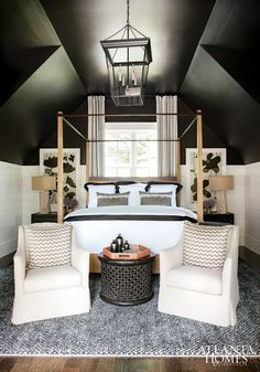 LOVE THIS symmetry in a bedroom. The two chairs at the foot of the bed are great