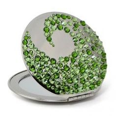 Compact mirror with green crystals