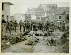 Canadians wounded at the Battle of Amiens lying outside of the 10th Field Ambulance Dressing Station. German prisoners of war are also dispersed through the crowd. They likely carried some of the wounded back to the dressing station and are now...