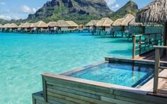 100 dreamy overwater bungalows at the foot of majestic Mount Otemanu.