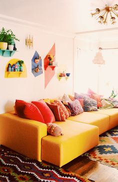 Bright and Colorful wall art installation by justina blakeney
