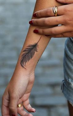 Indian Plume Feather Tattoo Ideas for Women - Black Arm Wrist Tat - MyBodiArt.com