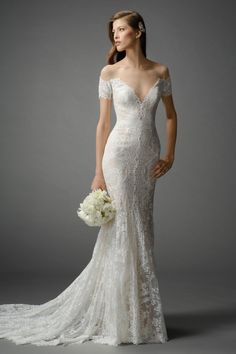 Sexy off-the-shoulder, fit and flare gown in Ballerina Lace with a deep V-neckline and contrast lining. Sweep Train.