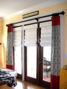#Windowtreatments  Ring curtains with 3 fabric sections over #romanshades