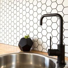 This stylish backsplash look is created with our Porcelain Hexagon mosaic. *prices valid through 2018 Kitchen Shelves, Kitchen Tiles, Kitchen Design, Glass Shelves, Kitchen Flooring, Contemporary Kitchen Backsplash, Kitchen Cabinets, Hexagon Tile Backsplash, Backsplash Ideas
