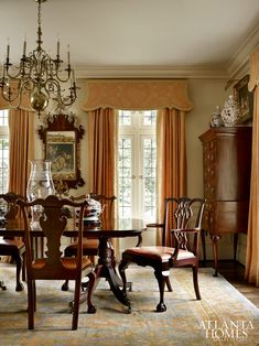 Storied Charm | Atlanta Homes & Lifestyles (highboy in dining room for storage)