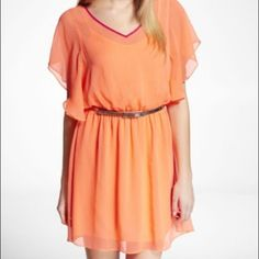 Orange/ Coral Keyhole Dress Effortlessly sexy and comfortable! Feminine keyhole detail in the back. Beautiful orange tone with purple details! Dresses