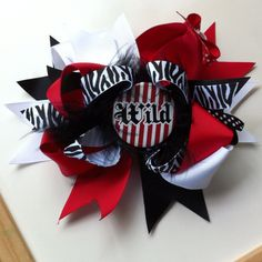 """Over the top bow in """"wild child"""" visit www.facebook.com/MandMinthemirror or contact me directly Jodig1223@aol.com"""