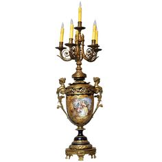 19th century monumental Sèvres vase supporting a six light bronze candelabra, converted to electric.  Cobalt blue-ground baluster form vase, cartouche outlined with chased gilt surround depicting a painting of a courting scene between a man and maiden, on the reverse side is a country scene.  A winged maiden surmounts bronze handles on either side, conforming socle base.  Sèvre mark of interlaced L's on base.