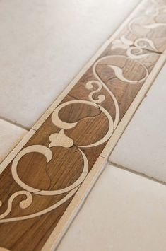 Decorative Borders - transition from tile to wood floor.