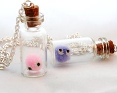 Worries about leaving your pet at home? Take them with you wherever you go with this Harry Potter Pygmy Puff Bottle Necklace.