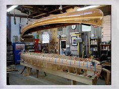 """Lucky Boy"" Western Red Cedar Strip-Planked Canoe built at Offerman wood shop Model: Redbird (Bear Mountain Boats) Design: Steve Killing and Ted Moores Almost Done 2011 Length: 17'-8"" Beam: 33-1/2"""