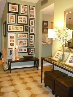 like the use of this small wall space with frames all the way up to ceiling and low table underneath