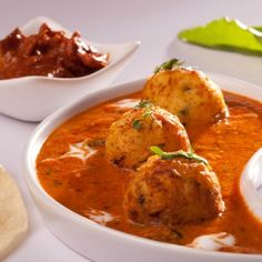 Dum Aloo Lakhnavi Recipe - Fried potatoes stuffed with paneer, mingled in a rich, masaledar onion and tomato gravy. Perfect dish to dazzle a crowd.