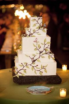 Cake with leaves but instead stucco icing on tree wood stand.