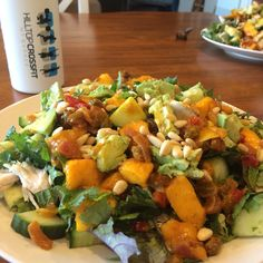 Fresh mango chutney with poached chicken salad topped with avocado and pine nuts