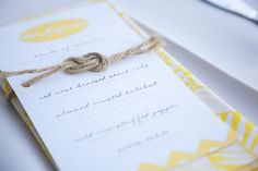 ABSOLUTELY LOVE the KNOT ....  menu design (homemade napkins too w/ fabric from etsy)