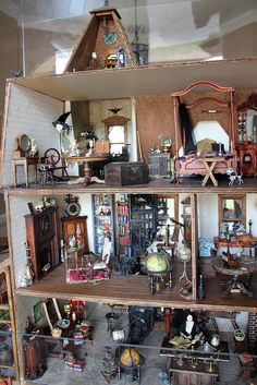 Haunted dollhouse. Um, this is pretty much the coolest dollhouse EVER! Click for more pics. I always wanted a dollhouse, now I want THIS one.